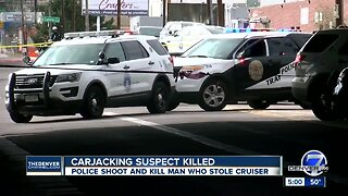 Person shot and killed in Denver after allegedly stealing officer's car, pointing rifle at people
