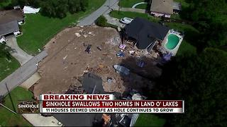 Sinkhole swallows 2 homes, continues to grow in Land O' Lakes - Video