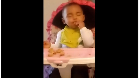 Tired Baby Practically Falls Asleep While Eating Her Favorite Snack