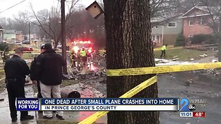 One dead after small plane crashes into home