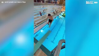 Guy makes incredible leap into pool after jumping between diving boards