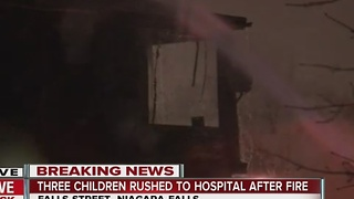 Three children rushed to hospital after fire - Video