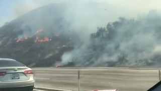 Fire Scorches Edges of Freeway in Corona, California - Video