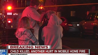 Child killed, another hurt in mobile home fire - Video