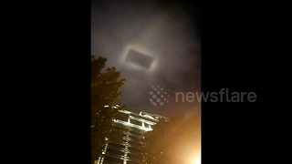 Rectangular 'UFO' Spotted Over Chinese Town - Video