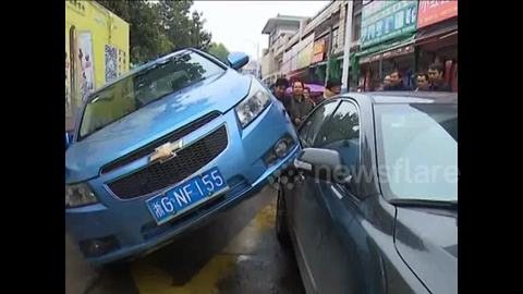 Car rides onto another one in eastern China
