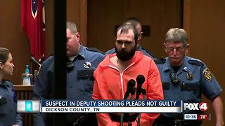 Man accused of killing a police officer pleads not guilty - Video