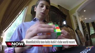 Bloomfield Hills teen holds Rubik's Cube world record - Video