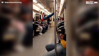 Spider-Man entertains subway passengers