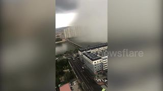 Strange ultra-localised downpour falls in northern China - Video