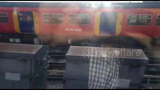Derailed train causes chaos at London Waterloo - Video