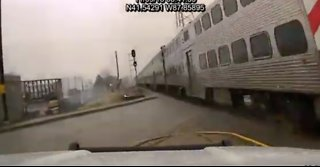 Mokena Police Patrol Car Narrowly Misses Oncoming Train After Crossing Gate Fails to Lower - Video