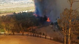 Firefighters Work to Contain Wind-Fueled Riverside Fire - Video