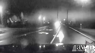 Cop Spots Eerie Figure Running Towards His Car At Night, Jumps Out When He Identifies It - Video