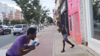 Youth challenge strangers to water gun duels