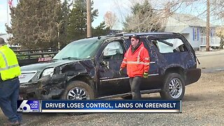 Drive loses control, lands on greenbelt
