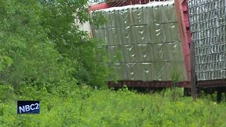 Road reopens after train derailment closes highway in Marinette County - Video