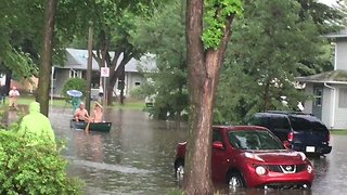 Saskatoon Residents Canoe Through Floodwater