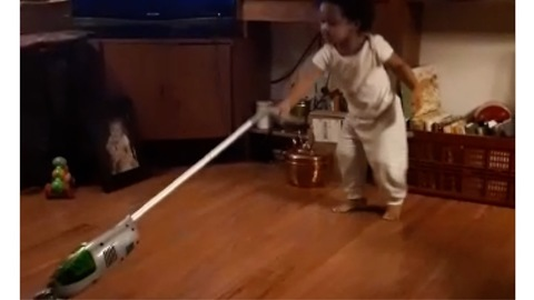 Watch this Adorable toddler dance up a storm while vacuuming  for mom