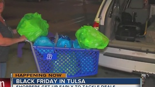 Tulsa shoppers spend hours tackling Black Friday deals - Video
