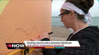 Artist painting mural at Kenosha lighthouse