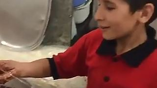 12-year-old Iranian boy who works like a man - Tehran - Video