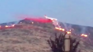Firefighting Plane Drops Retardant on Earthstone Fire Near Reno - Video