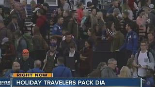 Holiday travelers pack DIA - Video