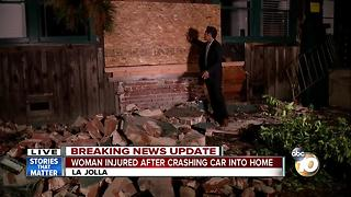 Woman injured after driving into La Jolla home - Video