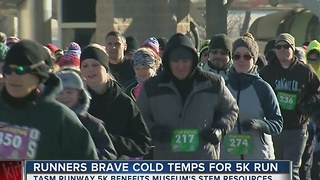 Single-digit temps don't stop Runway 5K runners - Video