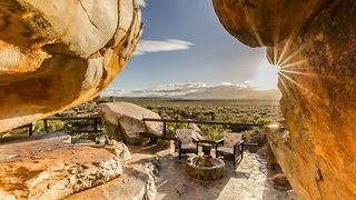 Now that's a room with a view! Luxury 'caveman' boutique offers beds under a rock in African wildreness  - Video