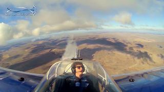 Multiple camera angles capture stunt plane's flawless flat spin - Video