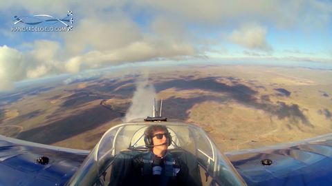 Multiple camera angles capture stunt plane's flawless flat spin