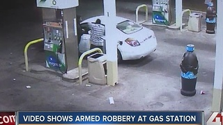 Video shows armed robbery at gas station - Video