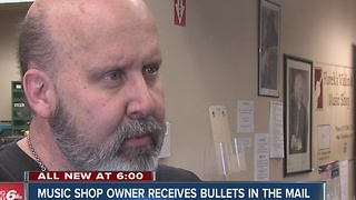 Bullets left as threat in music shop owner's mailbox - Video