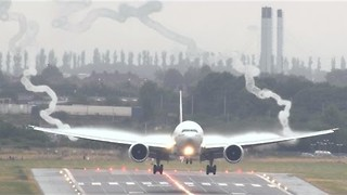 Dramatic Vortexes Form Behind Landing Plane - Video