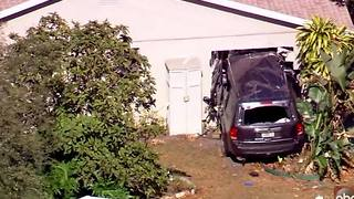Aerials from car into home accident - Video