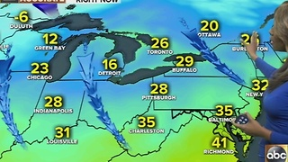 Dry, cloud cover with spotty showers possible later - Video