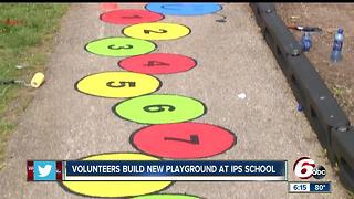 Volunteers build new playground at IPS school - Video