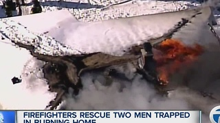 Firefighters rescue two men from house fire - Video