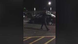 Canton cop nearly hit in Walmart parking lot - Bob Jones - Video