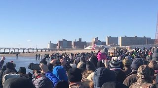 Beachgoers Dash Into Coney Island Water for Polar Bear Plunge