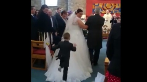 Kid Dives Onto Back Of Bride's Wedding Dress During Ceremony