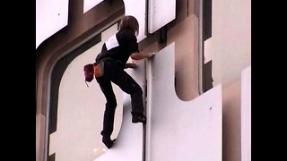 'Spiderman' Climbs French Tower - Video