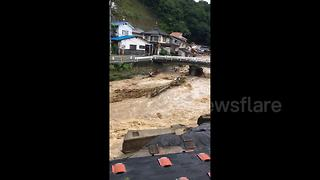 Eyewitness video shows collapsed homes after Japan floods - Video
