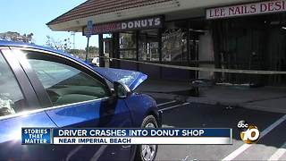 Car crashes into donut shop in South Bay - Video