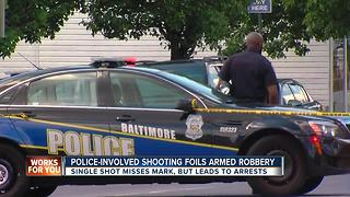 Police-involved shooting foils armed robbery - Video