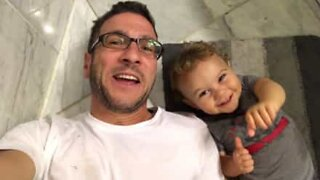 Father tries to teach adorable baby son how to say vowels