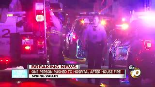 One person rushed to hospital after house fire - Video