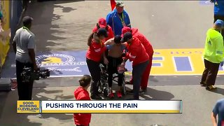 Marine from Tallmadge crawls across the Boston Marathon finish line